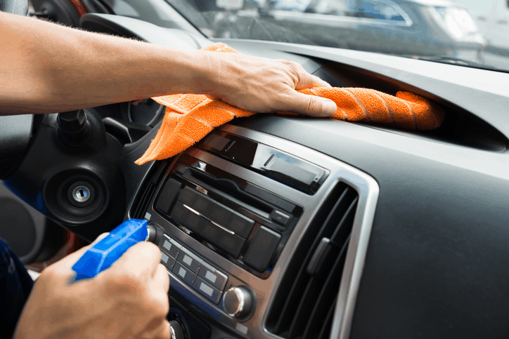 cleaning dust off of car dashboard